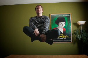 Man Levitating In Front of Amelie Poster